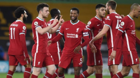 Liverpool forward Diogo Jota (20), midfielder Georginio Wijnaldum (5) and teammates
