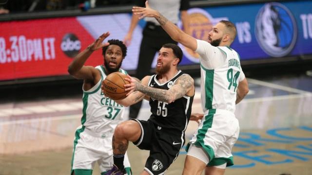 Brooklyn Nets forward Mike James (55), Boston Celtics power forward Semi Ojeleye (37) and shooting guard Evan Fournier (94)