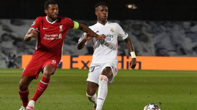 Liverpool midfielder Georginio Wijnaldum (left) and Real Madrid forward Vinicius Junior