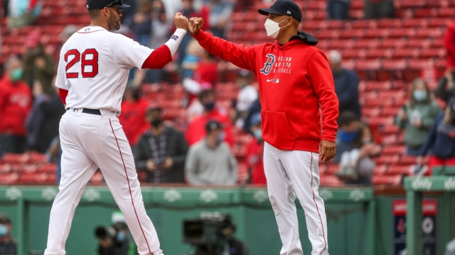 Boston Red Sox manager Alex Cora (right) and left fielder J.D. Martinez