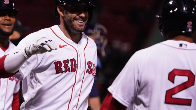 Boston Red Sox designated hitter J.D. Martinez (center), shortstop Xander Bogaerts (right) and outfielder Franchy Cordero (left)