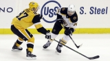Boston Bruins winger Jake DeBrusk, Pittsburgh Penguins center Sidney Crosby