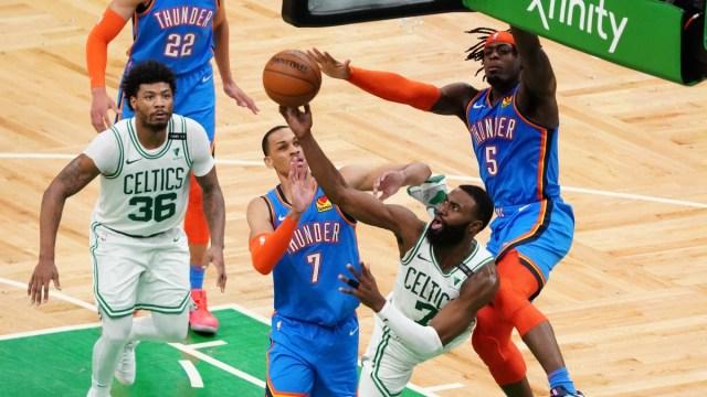 Oklahoma City Thunder forward Luguentz Dort (5) and forward Darius Bazley (7) and Boston Celtics guard Jaylen Brown (7)