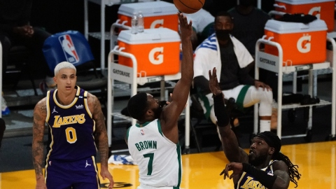 Boston Celtics guard Jaylen Brown (7) and Los Angeles Lakers center Montrezl Harrell (15)