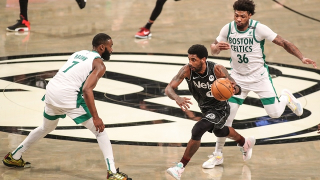Brooklyn Nets guard Kyrie Irving (11) and Boston Celtics guards Jaylen Brown (7) and Marcus Smart (36)