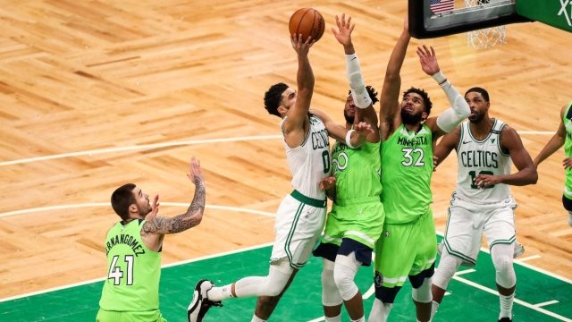 Boston Celtics forward Jayson Tatum (0) and Minnesota Timberwolves players
