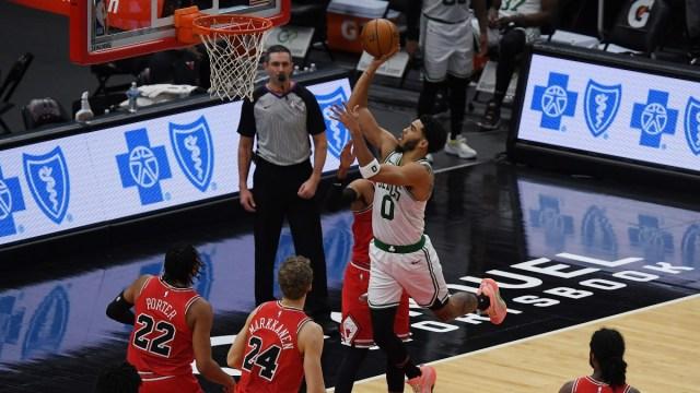 Boston Celtics forward Jayson Tatum (0) and Chicago Bulls players