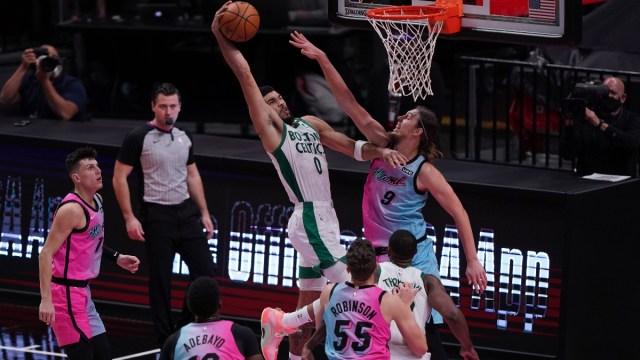 Boston Celtics forward Jayson Tatum (0) and Miami Heat forward Kelly Olynyk (9)