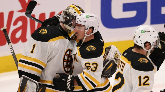 Boston Bruins goalie Jeremy Swayman And Forward Brad Marchand