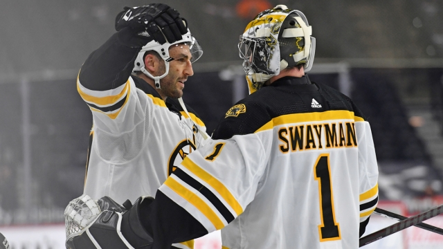 Boston Bruins Center Patrice Bergeron And Goalie Jeremy Swayman
