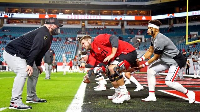 NFL Draft prospect Justin Fields (right)