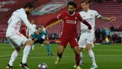 Liverpool forward Mohamed Salah (center), Real Madrid defender Nacho (left) and midfielder Toni Kross (right)