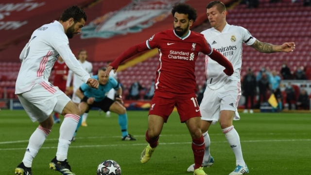Liverpool forward Mohamed Salah (center), Real Madrid defender Nacho (left) and midfielder Toni Kross (right)