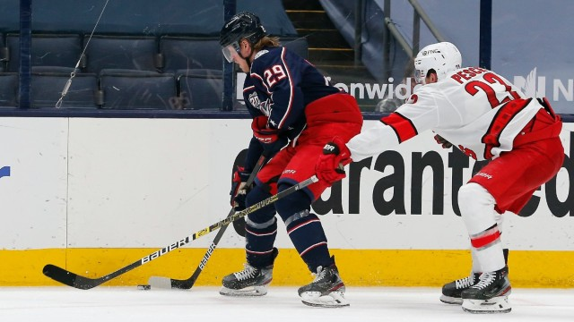 Columbus Blue Jackets winger Patrik Laine, Carolina Hurricanes defenseman Brett Pesce