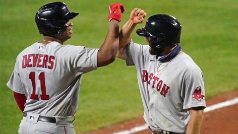 Boston Red Sox third baseman Rafael Devers (11) and outfielder Alex Verdugo (99)