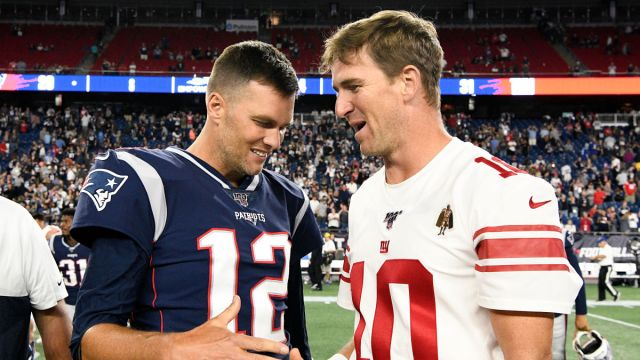 Tampa Bay Buccaneers quarterback Tom Brady, former New York Giants quarterback Eli Manning