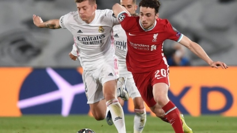 Real Madrid midfielder Toni Kross (left) and Liverpool forward Diogo Jota