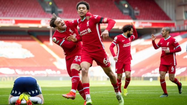 Liverpool defender Trent Alexander-Arnold (right) and forward Xherdan Shaqiri celebrate a goal against Aston Villa