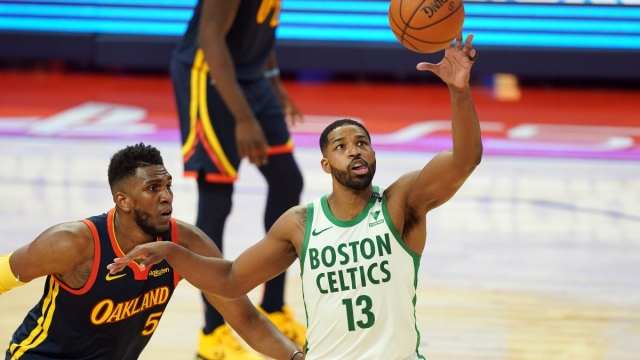 Boston Celtics center Tristan Thompson (13) and Golden State Warriors forward Kevon Looney (5)
