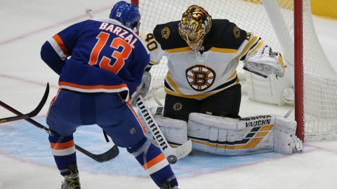 Boston Bruins goalie Tuukka Rask, New York Islanders center Mathew Barzal