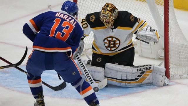 Boston Bruins goalie Tuukka Rask, New York Islanders center Mathew Barzal