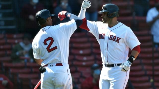Boston Red Sox shortstop Xander Bogaerts (2) and designated hitter J.D. Martinez (28)