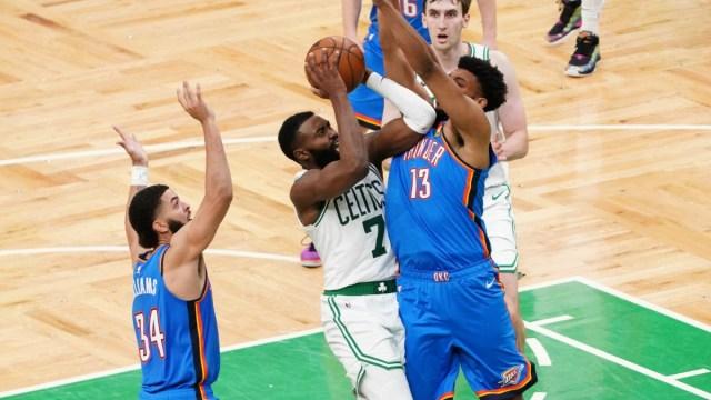 Oklahoma City Thunder center Tony Bradley and Boston Celtics guard Jaylen Brown