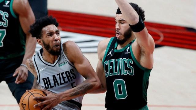 Portland Trail Blazers small forward Derrick Jones Jr. and Boston Celtics small forward Jayson Tatum