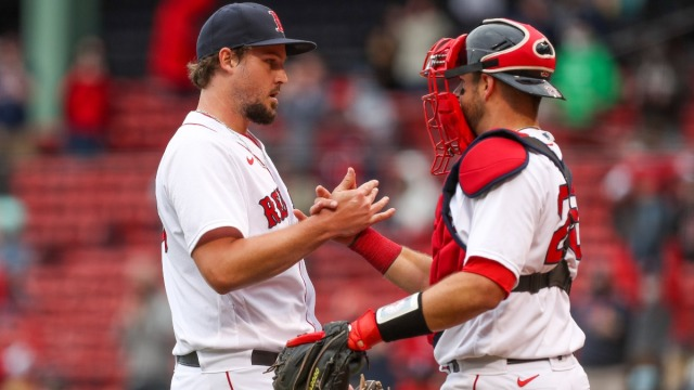 Boston Red Sox relief pitcher Josh Taylor and catcher Kevin Plawecki