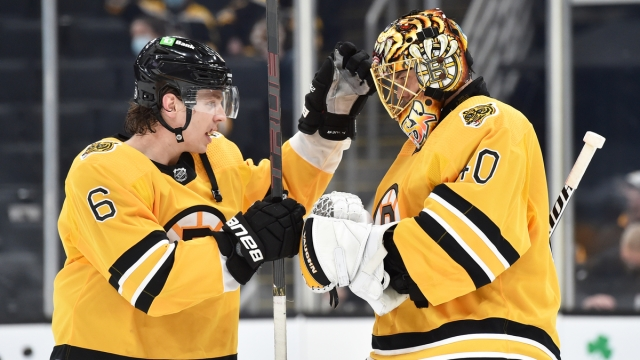 Boston Bruins defenseman Mike Reilly, goaltender Tuukka Rask