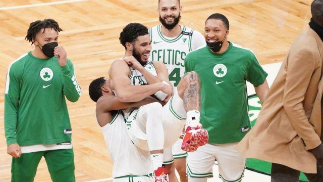 Boston Celtics players Carsen Edwards, Tristan Thompson, Jayson Tatum, Grant Williams, Evan Fournier
