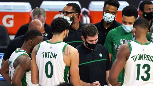 Boston Celtics head coach Brad Stevens, point guard Kemba Walker (left), forward Jayson Tatum (0) and center Tristan Thompson (13)