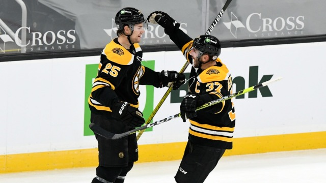 Boston Bruins Defenseman Brandon Carlo, Center Patrice Bergeron