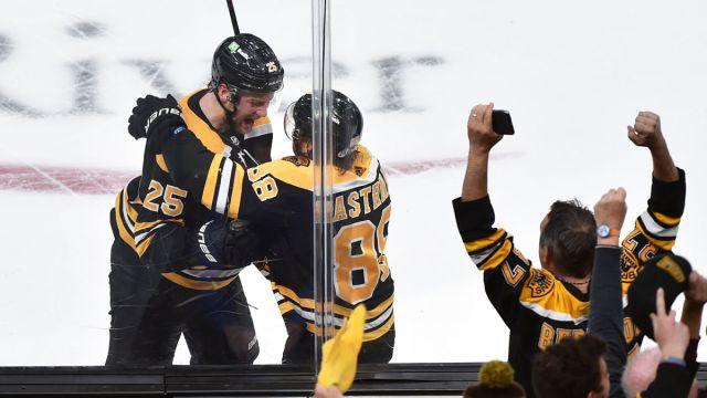Boston Bruins defenseman Brandon Carlo, forward David Pastrnak