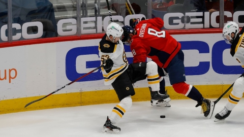 Washington Capitals left wing Alex Ovechkin (8) and Boston Bruins center Cameron Hughes (53)