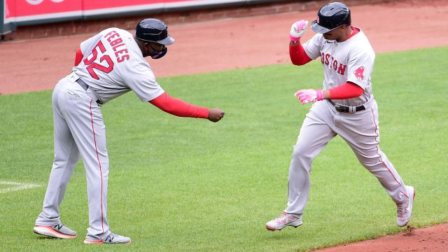Boston Red Sox third base coach Carlos Febles and third baseman Rafael Devers
