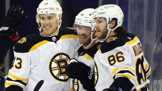 Boston Bruins forwards Charlie Coyle and Chris Wagner, defenseman Kevan Miller