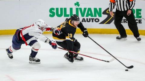 Boston Bruins winger Charlie Coyle (13) and Washington Capitals defenseman Dmitry Orlov (9)