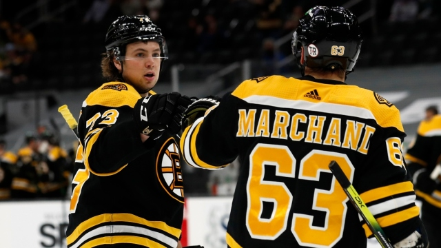 Boston Bruins left wing Brad Marchand (63) and defenseman Charlie McAvoy (73)