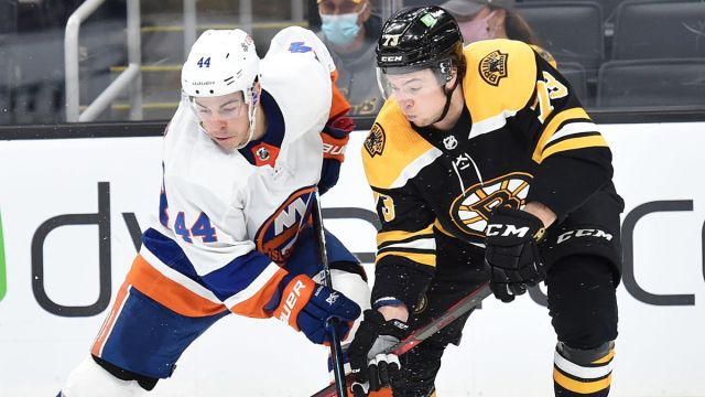 New York Islanders center J.G. Pageau and Boston Bruins defenseman Charlie McAvoy