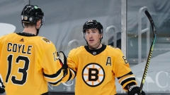 Boston Bruins Forwards Charlie Coyle And Brad MArchand