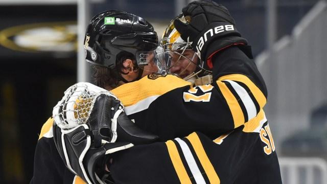 Boston Bruins winger Craig Smith, goalie Jeremy Swayman