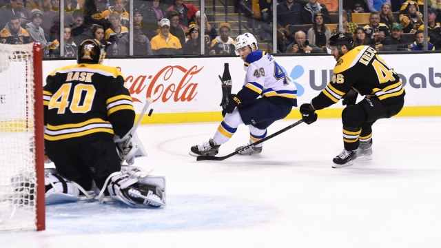 Boston Bruins goalie Tuukka Rask, center David Krejci, St. Louis Blues forward Ivan Barbashev