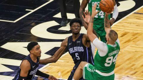 Boston Celtics' Evan Fournier, Orlando Magic's Mo Bamba, Gary Harris