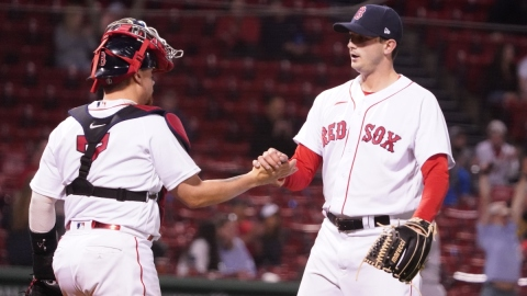 Boston Red Sox catcher Christian Vázquez and pitcher Garrett Whitlock (right)