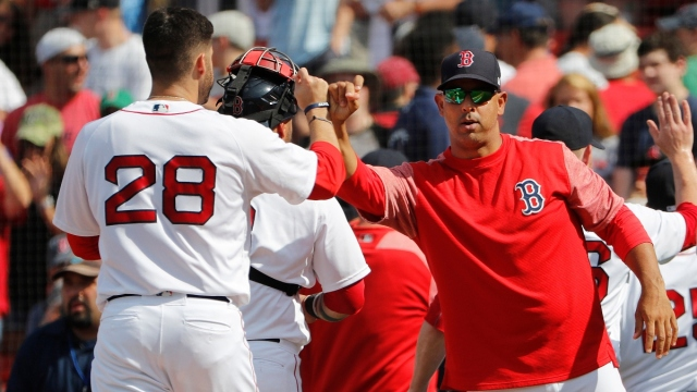 Boston Red Sox manager Alex Cora and designated hitter J.D. Martinez (28)
