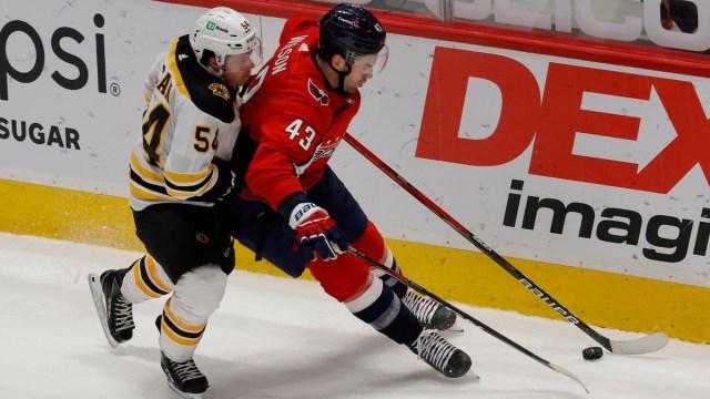 Boston Bruins defenseman Jack Ahcan, Washington Capitals winger Tom Wilson