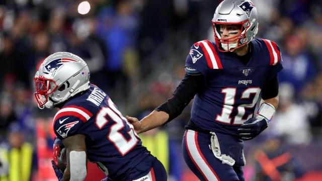 Patriots running back James White, Buccaneers quarterback Tom Brady