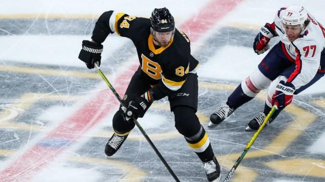 Boston Bruins defenseman Jarred Tinordi, Washington Capitals forward T.J. Oshie