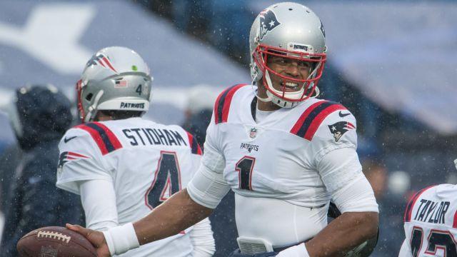New England Patriots quarterbacks Jarrett Stidham and Cam Newton